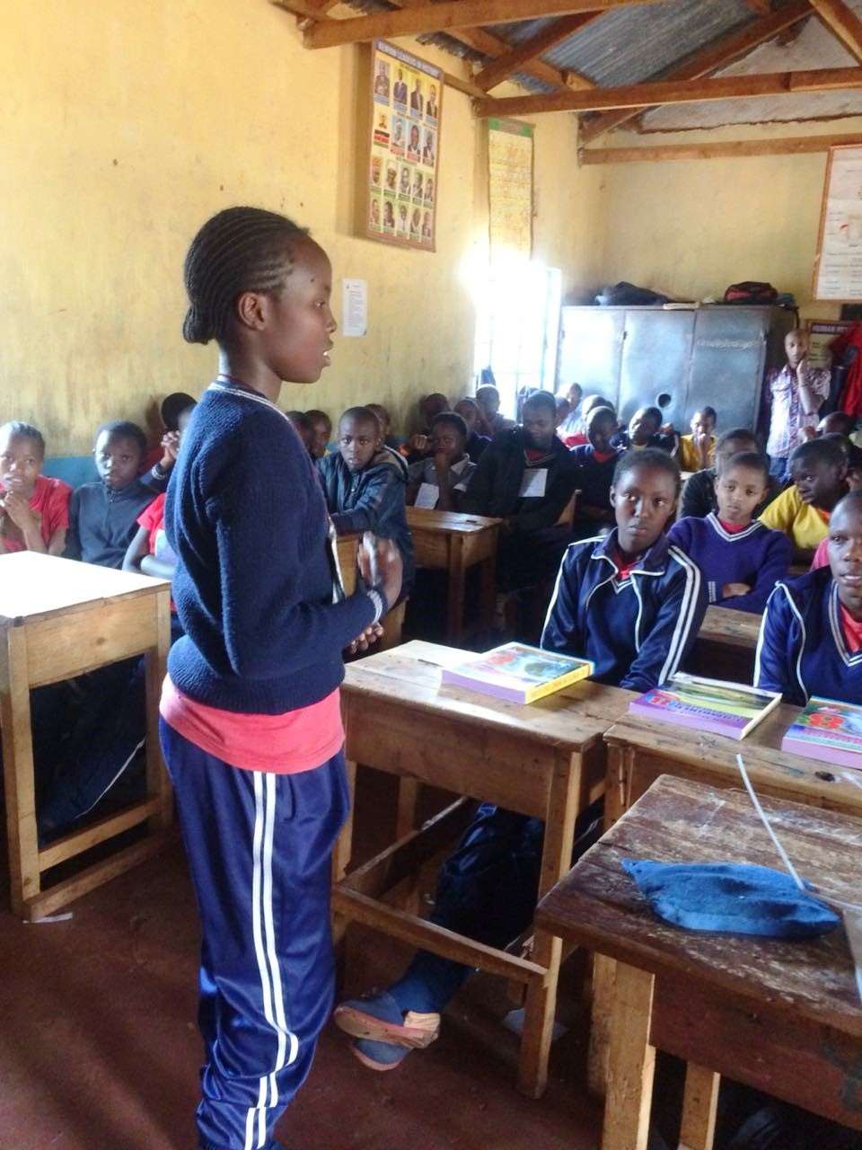 Girls speaking to fellow pupils June 18